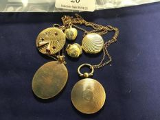 A mixed lot of yellow metal pendants and lockets, including a circular engine turned locket,