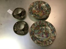 A pair of 19thc Chinese Exportware famille rose decorated dishes, the centre panel with scenes of