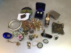 A collection of jewellery including a hinged white metal bangle, a Norwegian style white metal