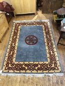 A modern hand knotted carpet, the blue/grey field with knotwork medallion within a camel guard
