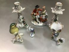 A pair Dresden baluster rococo style candlesticks with floral encrusted and gilded decoration,