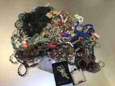 A large collection of costume jewellery including paste pearl necklaces, freshwater style pearl bead
