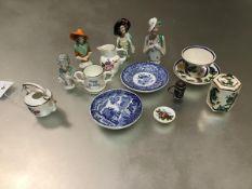 A mixed lot comprising a set of four porcelain pomander/pin cushion figure heads, a Spode