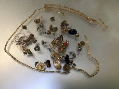A quantity of assorted jewellery including earrings, gilt metal chains, 9ct gold chains, a Maltese