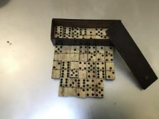 A late 19thc set of dominoes (27), mounted with bone and ebony, in a treen box with sliding top (h.