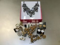 A collection of costume jewellery including a Butler & Wilson paste set floral necklace, earrings,