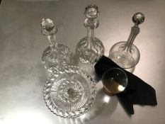 A group of three slice cut and engraved decanters, a moulded glass tazza (h.10cm x d.20cm)and a