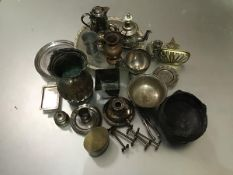 A collection of Epns ware to include a salver, knife rests, nutcrack, a chamber candlestick, a