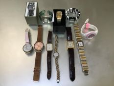 A collection of eleven watches including a Mappin & Webb gilt metal watch on lizard strap, a Sekonda