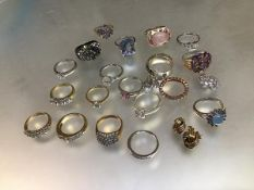 A collection of white metal and yellow metal and silver QVC style dress rings including three