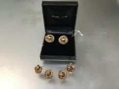 A pair of 9ct gold stud earrings of tubular spiral design and two pairs of 9ct gold knot earrings (a