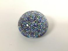 A Murano millefiore glass paperweight (d.9cm) with floral canes, paper label verso