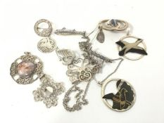 A collection of silver Celtic style brooches including a St Ninian's Isle miniature brooch, a