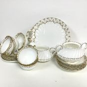 A mixed china tea service including a crescent china set of six saucers, five side plates, six cups,