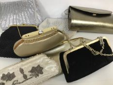 A collection of evening bags including silver purses, velvet purses, beaded bags etc. (8)