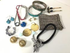 A group of costume jewellery including a pair of gilt metal ball earrings, a pair of circular disk