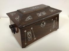 A 19thc rosewood sarcophagus shaped tea caddy inlaid with mother of pearl decoration, with ring