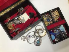 A mixed lot of jewellery including two boxes with silver bangles, yellow metal earrings, glass