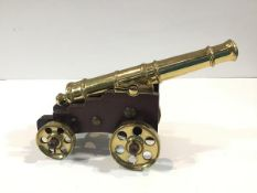 A bronze model naval cannon, early 20th century, the tapering multi-stage barrel with flared muzzle,