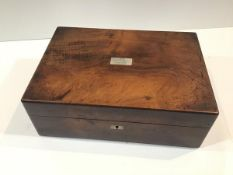 A Victorian mahogany work box, of plain rectangular form, the cover inlaid with a mother of pearl