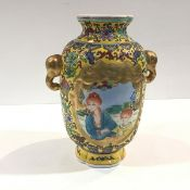 A modern Chinese yellow-ground porcelain vase, of baluster shape, painted with figural panels amidst