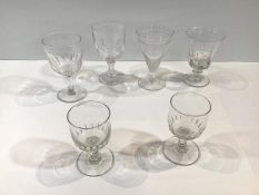 A group of 19th century drinking glasses comprising: a rummer with cup-shaped bowl, with thumb-cut