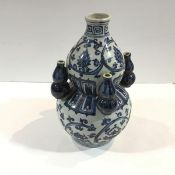 A Chinese blue and white porcelain tulip vase, of double gourd form, with four baluster-form