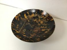A 1900- 1920's tortoiseshell gilt lacquer footed bowl depicting cranes with bamboo (h.7cm x d.24cm)