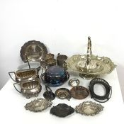 An assortment of Epns including a milk jug, sugar bowl, swing handled basket, mugs etc. (a lot)