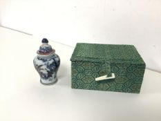 A Chinese snuff bottle of vase form with Imari pattern decoration, with box, spoon lacking (h.8cm)