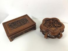 A Chinese cherrywood fretwork rectangular stand, the central foliate motif with bats to each