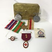 A mixed lot including a Princess Mary Christmas tin (3cm x 13cm x 8cm), a WWII Defence medal, a