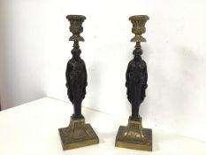 A pair of cast brass candlesticks of classical inspired design, with the stem in the form of
