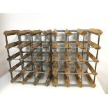 A pair of wine bottle racks with wooden and metal frames, each for twelve bottles (a/f) (44cm x
