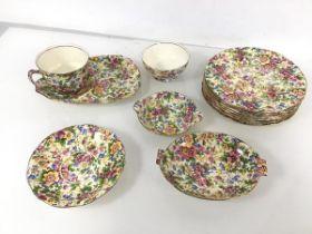 A collection of Royal Winton 1950s tea wares including a teacup, sugar bowl, saucer, seven side