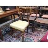 A Victorian rosewood side chair with stuffover seat, on fluted tapered supports (85cm x 44cm)