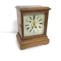 A 1950s oak mantel clock, the dial with Roman numerals and subsidiary dial with Arabic numerals,