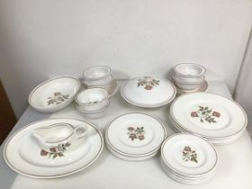 A Wedgwood Susie Cooper dinner service including six dinner plates (d.27cm), six soup bowls (one a/