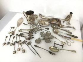 A mixed lot including a metal five petal flower, each petal removeable, base marked Italy, a pair of