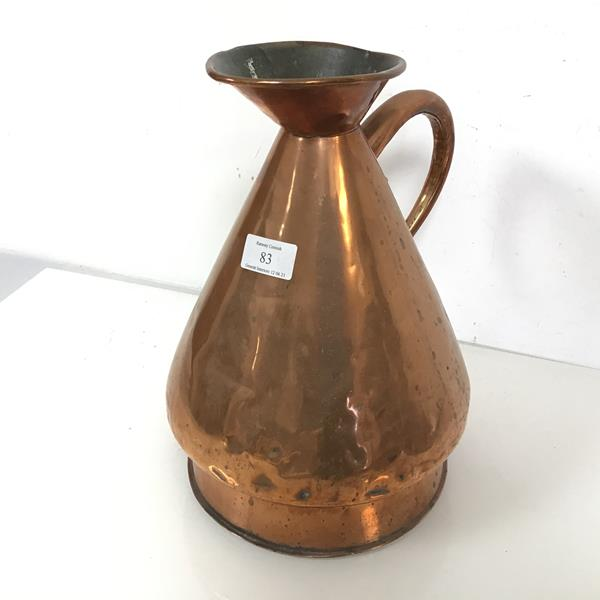 A copper flagon with flared rim and spout, with handle to side (31cm x 21cm)