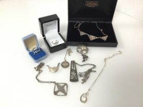 An assortment of jewellery including an Ortak silver necklace with Celtic knots, and ring with
