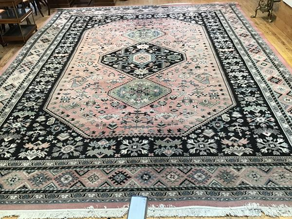 A super kashan rug, the central octagon with three medallions enclosed within a multiple stylised