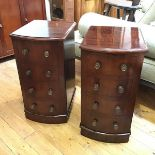 A pair of 19thc bedside cabinets, formerly the supports for a pedestal desk, each fitted single door