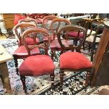 A harlequin set of four Victorian mahogany balloon back style dining chairs and two similar dining