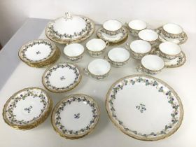 A late 19thc Minton teaset, including eleven teacups and saucers, side plates, serving dish (d.