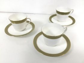 A set of three Royal Doulton teacups and saucers, in Belvedere pattern (teacup: 7cm x 11cm x 8cm)