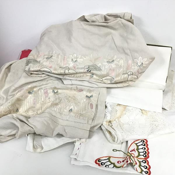 An assortment of 1930s and later linen including table cloths, bed sheets, pillowcases, some with