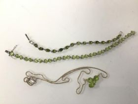 A silver peridot pendant necklace (25cm), and a pair of peridot silver bracelets (3)