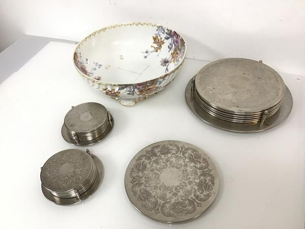 A Havilland & Co. footed bowl with gilt and floral decoration (a/f) (11cm x 26cm) and metal coasters