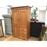 A modern John Lewis pine upright gentleman's linen style press with twin panel doors to top above